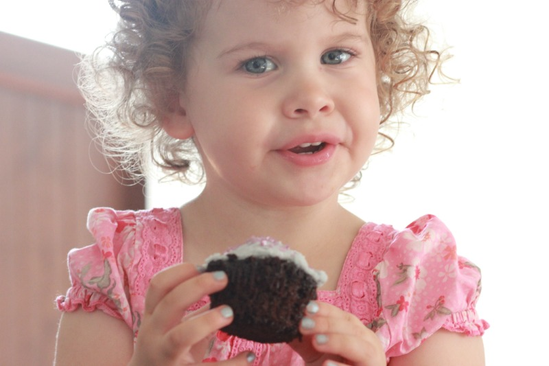 Anastasia eating chocolate cupcakes